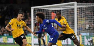 Willian in action while under pressure from Romain Saiss of Wolverhampton Wanderers and Willy Boly of Wolverhampton Wanderers during the Premier League match between Wolverhampton Wanderers and Chelsea FC at Molineux on December 4, 2018 in Wolverhampton.