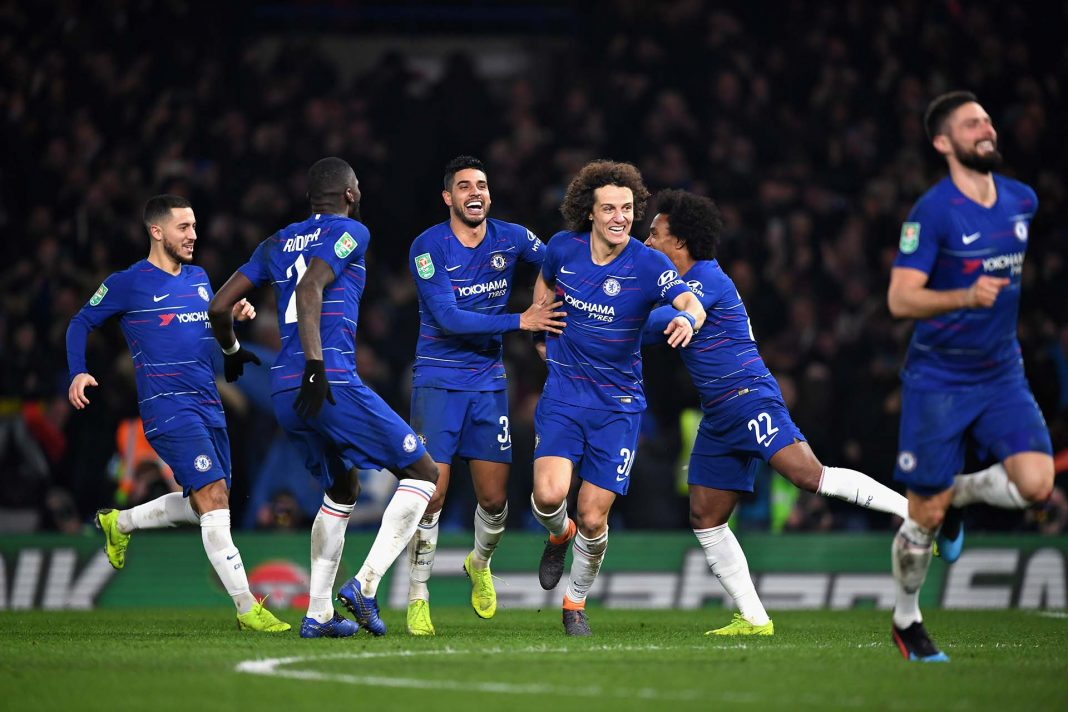 David Luiz celebrates after scoring the winning penalty during the Carabao Cup Semi-Final Second Leg match between Chelsea and Tottenham Hotspur at Stamford Bridge on January 24, 2019 in London.