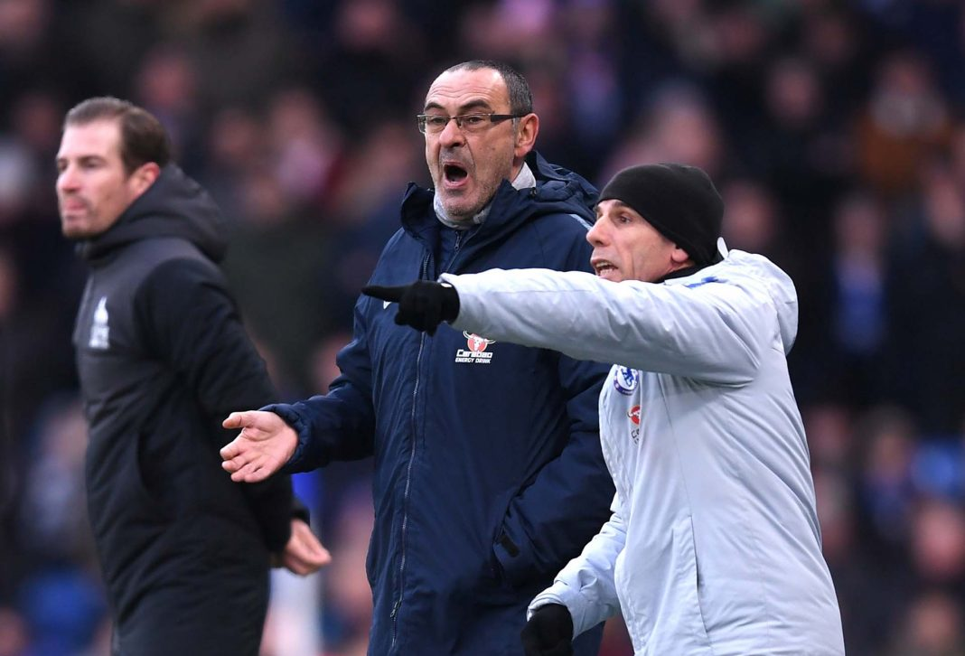 Maurizio Sarri, Manager and Gianfranco Zola, Assistant Manager reacts during the Premier League match between Chelsea FC and Huddersfield Town at Stamford Bridge on February 2, 2019 in London.