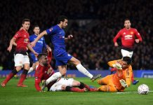 Sergio Romero of Manchester United attempts to save from Pedro during the FA Cup Fifth Round match between Chelsea and Manchester United at Stamford Bridge on February 18, 2019 in London.