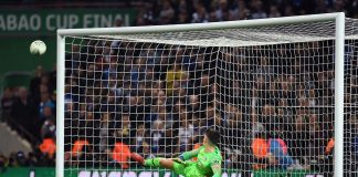 Kepa Arrizabalaga of watches as Raheem Sterling of Manchester City scores the crucial penalty during the penalty shoot out in the Carabao Cup Final between Chelsea and Manchester City at Wembley Stadium on February 24, 2019 in London.