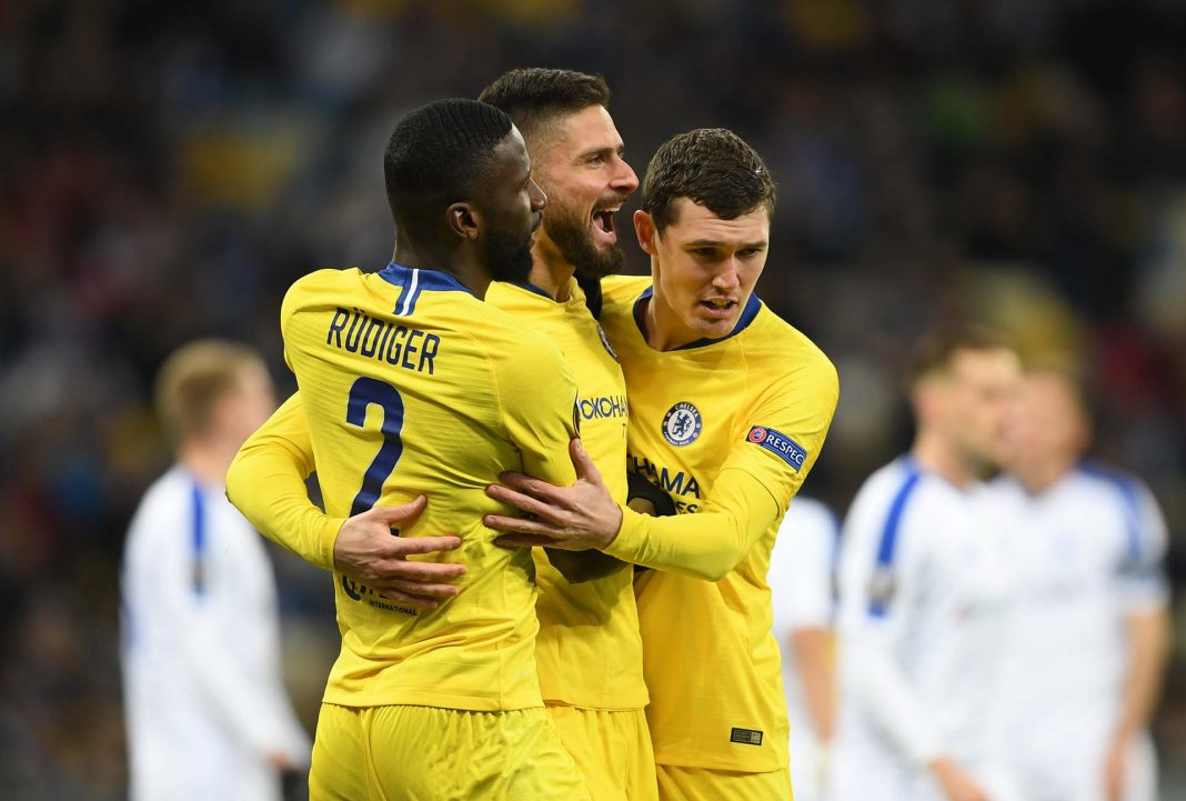 Olivier Giroud celebrates with teammates Antonio Ruediger and Andreas Christiansen after scoring his team's first goal during the UEFA Europa League Round of 16 Second Leg match between Dynamo Kyiv and Chelsea at NSC Olimpiyskiy Stadium on March 14, 2019 in Kiev, Ukraine.
