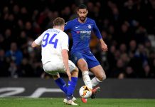 Ruben Loftus-Cheek is challenged by Tomasz Kedziora of Dynamo Kyiv during the UEFA Europa League Round of 16 First Leg match between Chelsea and Dynamo Kyiv at Stamford Bridge on March 07, 2019 in London.