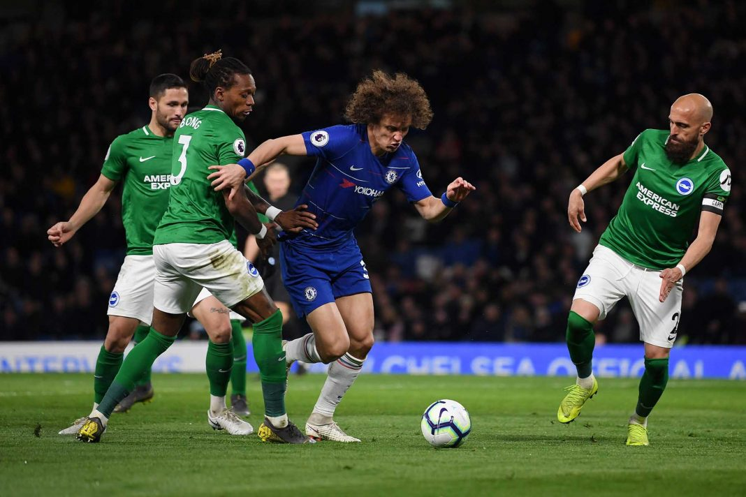 David Luiz is challenged by Gaetan Bong of Brighton and Hove Albion during the Premier League match between Chelsea FC and Brighton & Hove Albion at Stamford Bridge on April 03, 2019 in London.