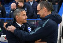 Chris Hughton, Manager of Brighton and Hove Albion embraces Maurizio Sarri prior to the Premier League match between Chelsea FC and Brighton and Hove Albion at Stamford Bridge on April 03, 2019 in London.