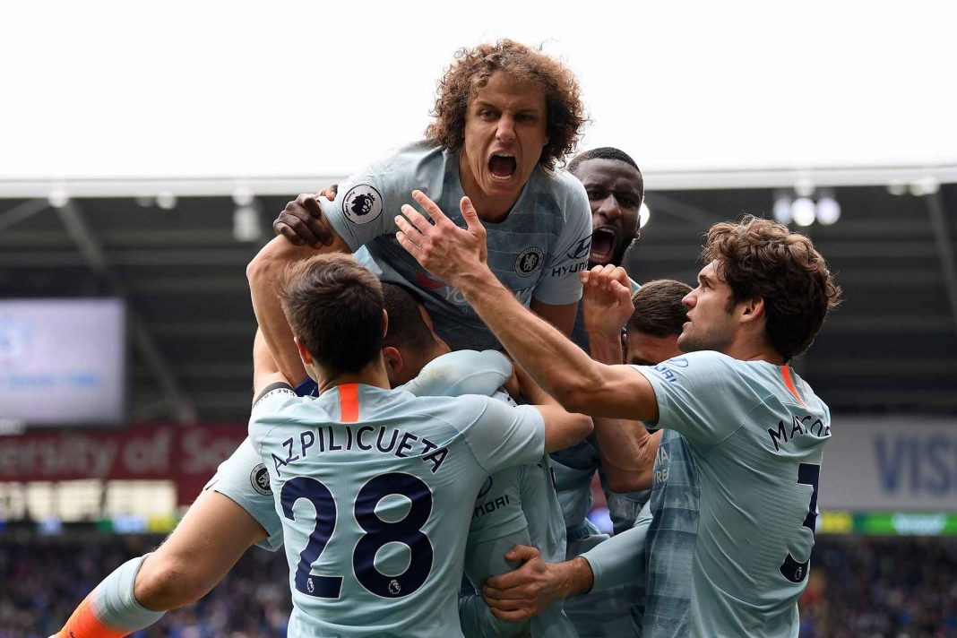 David Luiz celebrates with Cesar Azpilicueta and teammates after Ruben Loftus-Cheek of Chelsea scores his sides second goal during the Premier League match between Cardiff City and Chelsea FC at Cardiff City Stadium on March 31, 2019 in Cardiff.