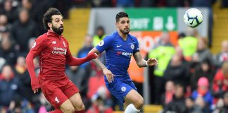 Emerson and Mohamed Salah of Liverpool watch the ball during the Premier League match between Liverpool FC and Chelsea FC at Anfield on April 14, 2019 in Liverpool.