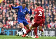 Ruben Loftus-Cheek of Chelsea takes on Andy Robertson of Liverpool during the Premier League match between Liverpool FC and Chelsea FC at Anfield on April 14, 2019 in Liverpool.