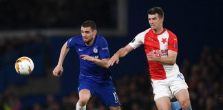 Mateo Kovacic and Simon Deli of SK Slavia Praha clash during the UEFA Europa League Quarter Final Second Leg match between Chelsea and Slavia Praha at Stamford Bridge on April 18, 2019 in London.