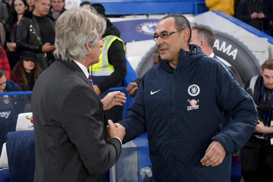 Manuel Pellegrini, Manager of West Ham United shakes hands with Maurizio Sarri prior to the Premier League match between Chelsea FC and West Ham United at Stamford Bridge on April 08, 2019 in London.