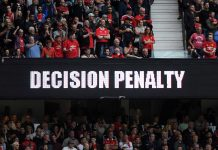 The LED screen shows information during a VAR penalty check during the Premier League match between Manchester United and Chelsea FC at Old Trafford on August 11, 2019 in Manchester.