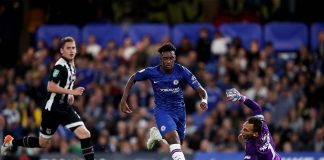 Callum Hudson-Odoi runs round James McKeown of Grimsby Town during the Carabao Cup Third Round match between Chelsea FC and Grimsby Town at Stamford Bridge on September 25, 2019 in London.