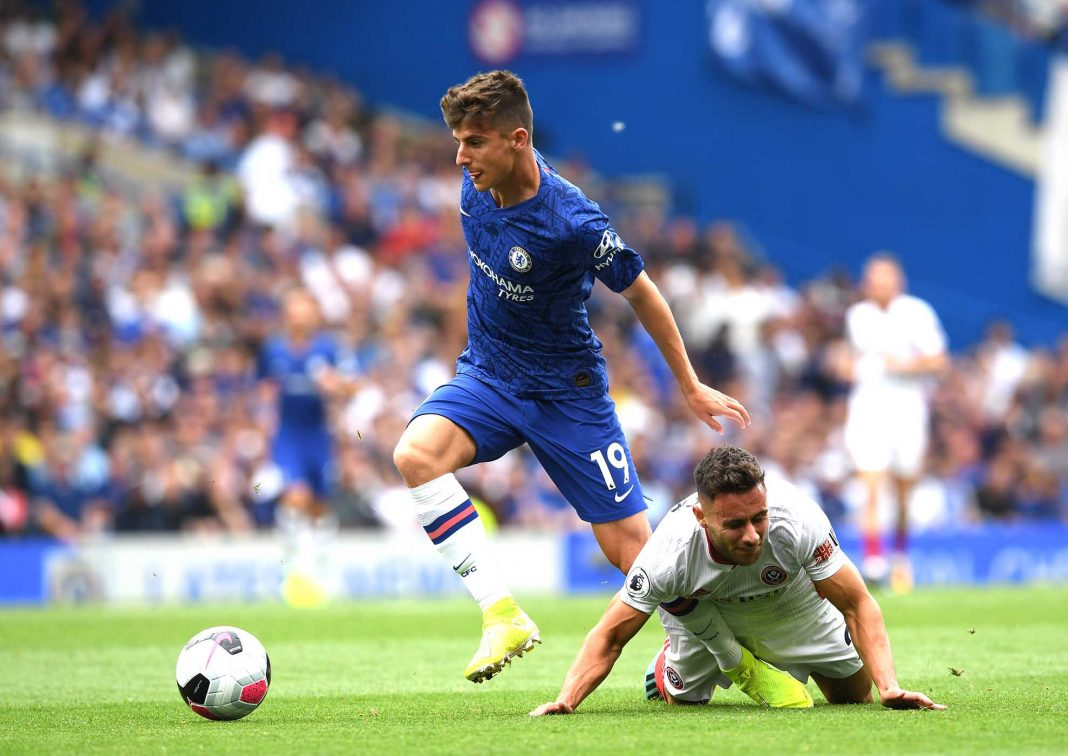 Mason Mount is tackled by George Baldock of Sheffield United during the Premier League match between Chelsea FC and Sheffield United at Stamford Bridge on August 31, 2019 in London.