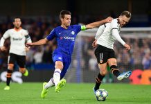 Cesar Azpilicueta battles with Denis Cheryshev of Valencia during the UEFA Champions League group H match between Chelsea FC and Valencia CF at Stamford Bridge on September 17, 2019 in London.