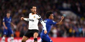 Willian evades Daniel Parejo of Valencia during the UEFA Champions League group H match between Chelsea FC and Valencia CF at Stamford Bridge on September 17, 2019 in London.