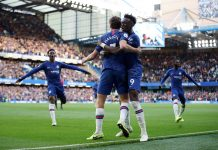 Marcos Alonso celebrates with teammate Tammy Abraham after scoring his team's first goal during the Premier League match between Chelsea FC and Newcastle United at Stamford Bridge on October 19, 2019 in London.