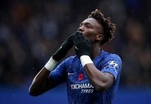 Tammy Abraham of Chelsea celebrates after scoring his team's first goal during the Premier League match between Chelsea FC and Crystal Palace at Stamford Bridge on November 09, 2019 in London.
