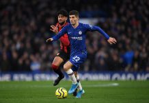 Christian Pulisic runs with the ball under pressure from Philip Billing of AFC Bournemouth during the Premier League match between Chelsea FC and AFC Bournemouth at Stamford Bridge on December 14, 2019 in London.