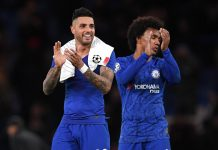 Emerson Palmieri and Willian celebrate during the UEFA Champions League group H match between Chelsea FC and Lille OSC at Stamford Bridge on December 10, 2019 in London.