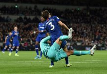 Paulo Gazzaniga of Tottenham Hotspur collides with Marcos Alonso in the area which results in a penalty awarded to Chelsea during the Premier League match between Tottenham Hotspur and Chelsea FC at Tottenham Hotspur Stadium on December 22, 2019 in London.